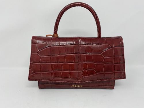 Hübsche Lederhandtasche in Krokoprägung rubino 219.- jetzt 109.50